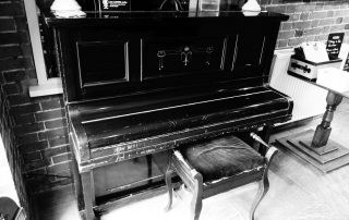 Battered piano in Warwickshire, England