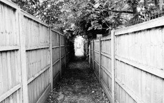 Fenced alleyway