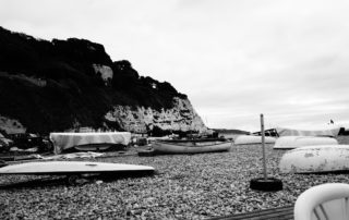 Some resting boats on a pebbly beach in Devon, England