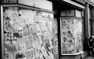 A boarded up news paper shop in Devon, England