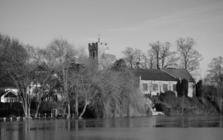 A flooded church river in Warwickshire, England