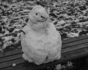 Frozen Snowman on a bench in Warwickshire, England