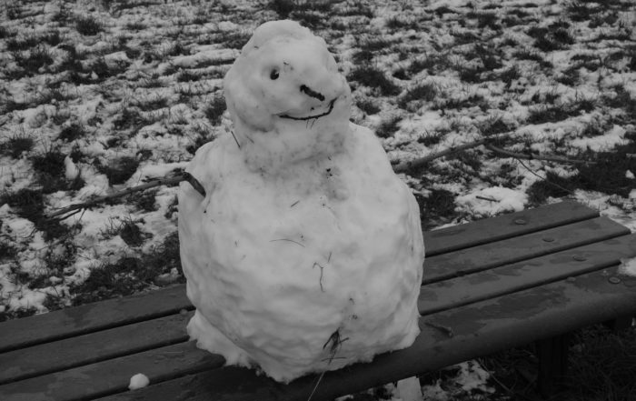 Frozen Snowman on a bench in Warwickshire, England